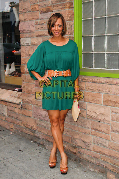 ANGELA RAWNA.arrives to the Los Angeles Premiere of 'Colin Fitz Lives,' at the Aero Theatre. Santa Monica, CA, USA, .August 5th, 2010. .full length green dress hand on hip brown waist belt .CAP/CEL/TC. ©Tim Copeland/CelPh/Capital Pictures.