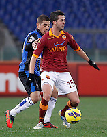 Calcio, ottavi di finale di Coppa Italia: Roma vs Atalanta. Roma, stadio Olimpico, 11 dicembre 2012..AS Roma midfielder Miralem Pjanic, of Bosnia, is challenged by Atalanta midfielder Carlos Carmona, of Chile, left during their Italy Cup last-16 tie football match between AS Roma and Atalanta at Rome's Olympic stadium, 11 December 2012..UPDATE IMAGES PRESS/Isabella Bonotto