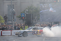 Red Bull Racing car burns tyres during the Great Run sports car show held in downtown Budapest, Hungary on May 1, 2019. ATTILA VOLGYI