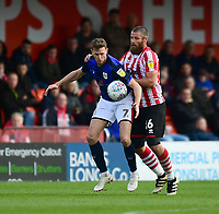 Crewe Alexandra's Chris Porter shields the ball from Lincoln City's Michael Bostwick<br /> <br /> Photographer Chris Vaughan/CameraSport<br /> <br /> The EFL Sky Bet League Two - Lincoln City v Crewe Alexandra - Saturday 6th October 2018 - Sincil Bank - Lincoln<br /> <br /> World Copyright &copy; 2018 CameraSport. All rights reserved. 43 Linden Ave. Countesthorpe. Leicester. England. LE8 5PG - Tel: +44 (0) 116 277 4147 - admin@camerasport.com - www.camerasport.com
