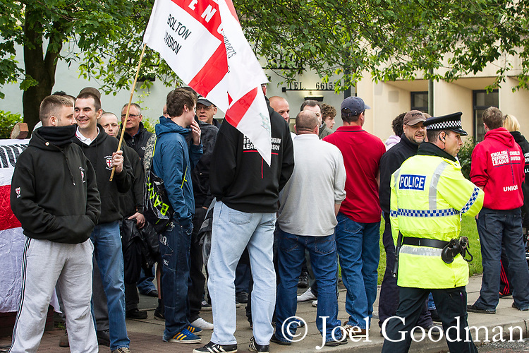© Joel Goodman - 07973 332324 . 24/06/2011 . Blackburn, UK . Supporters of EDL leader Tommy Robinson ( aka Stephen Yaxley-Lennon ) demonstrate outside Blackburn Magistrates Court as Robinson faces his first appearance related to charges for an assault at an EDL demonstration in Blackburn on 2nd April 2011 . Photo credit : Joel Goodman