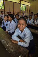 Nepal, Ghorkha. Students attending the opening day of the newly built Shakti Secondary school. The previous school had been severely damaged by the earthquake. Sponsored by the Nepal Youth Foundation. Girls in class.