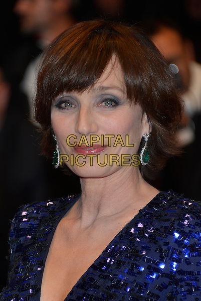 Kristin Scott Thomas .'Only God Forgives' premiere at the 66th  Cannes Film Festival, France 22nd May 2013.headshot portrait eyeshadow dangling green earrings blue sequins sequined  .CAP/PL.©Phil Loftus/Capital Pictures.