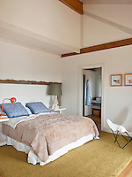 General view of the master bedroom with double height ceiling looking towards the ensuite bathroom
