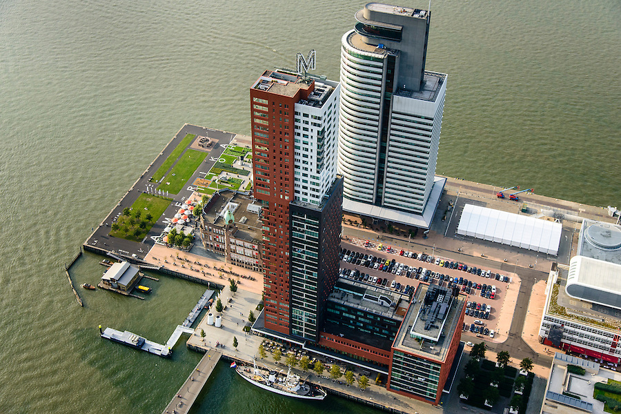 Nederland, Zuid-Holland, Rotterdam-Zuid, 28-09-2014; Kop van Zuid en Wilhelminakade, met Hotel New York en de torens van Montevideo en het World Port Center (Havenbedrijf Rotterdam).<br /> Newly developed cultural center Kop van Zuid, urban renewal and modern architecture, high rise in a former harbour area.<br /> luchtfoto (toeslag op standard tarieven);<br /> aerial photo (additional fee required);<br /> copyright foto/photo Siebe Swart.