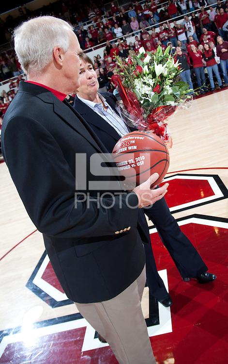 STANFORD, CA - January 8, 2011: President John Hennessy and Coach Tara VanDerveer during VanDerveer's 800th career win celebration after Stanford's game against Arizona State at Maples Pavilion. Stanford won 82-35.