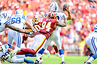 Landover, MD - September 16, 2018: Indianapolis Colts quarterback Andrew Luck (12) is hit in the backfield by Washington Redskins linebacker Preston Smith (94) during game between the Indianapolis Colts and the Washington Redskins at FedEx Field in Landover, MD. The Colts defeated the Redskins 21-9.(Photo by Phillip Peters/Media Images International)
