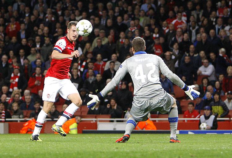 Arsenal's Aaron Ramsey scores his sides third goal 3-1..Football - UEFA Champions League Group B - Arsenal v Olympiakos FC - Wednesday 3rd October 2012 - Emirates Stadium - London..