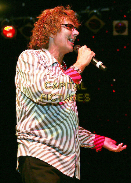 "MICKEY THOMAS .of 'Starship"" on the first night of the Starship/Toto Tour at the Wildhorse Saloon, Nashville, TN, USA, .22nd May 2009..half length microphone profile glasses striped shirt brown and white music gig concert on stage live .CAP/ADM/RR.©Randi Radcliff/Admedia/Capital Pictures"