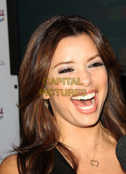 EVA LONGORIA PARKER.Kids with Cancer Press Conference held at the Glendale Galleria, Glendale, California, USA,.31st March 2009..portrait headshot funny mouth gold necklace smiling funny laughing .CAP/ADM/KB.©Kevan Brooks/Admedia/Capital PIctures