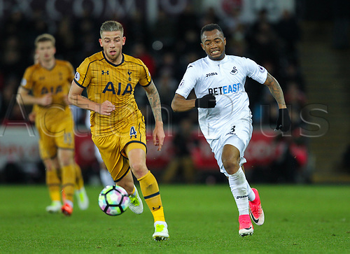April 5th 2017,  Liberty Stadium, Swansea , Wales; EPL Premier league football, Swansea versus Tottenham Hotspur; Jordan Ayew  of Swansea City (R) and Toby Alderweireld  of Tottenham Hotspur (L) chase a loose ball
