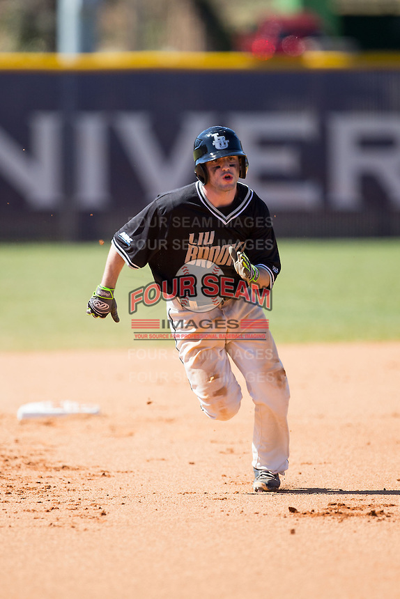Charles Misiano (11) of the LIU-Brooklyn Blackbirds hustles towards third base against the High Point Panthers at Willard Stadium on March 8, 2015 in High Point, North Carolina.  The Panthers defeated the Blackbirds 9-0.  (Brian Westerholt/Four Seam Images)
