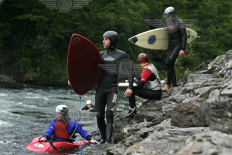 Nestled amongst snowcapped mountains,  and over 100 kilometers from any saltwater, the village of Voss may seem an unlikely spot for surfing. That doesn't stop a group of  of local surfers who has found several spots in rivers nearby...The rivers around Voss has been popular with kayakers for years, now they have to share the waves with the surfers. © Fredrik Naumann
