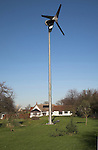 Domestic wind turbine in garden of house Suffolk England