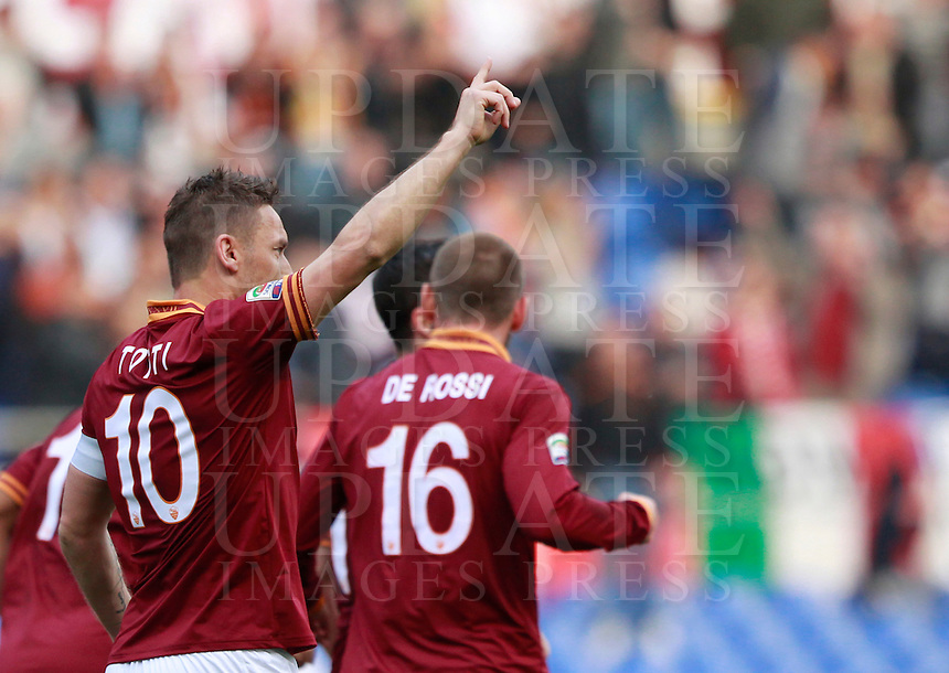 Calcio, Serie A: Roma vs Parma. Roma, stadio Olimpico, 2 aprile 2014.<br /> AS Roma forward Francesco Totti celebrates after scoring during the Italian Serie A football match between AS Roma and Parma at Rome's Olympic stadium, 2 April 2014.<br /> UPDATE IMAGES PRESS/Isabella Bonotto