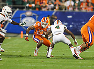 Charlotte, NC - December 2, 2017: Clemson Tigers running back Adam Choice (26) runs the ball during the ACC championship game between Miami and Clemson at Bank of America Stadium in Charlotte, NC.  (Photo by Elliott Brown/Media Images International) Clemson defeated Miami 38-3 for their third consecutive championship title.