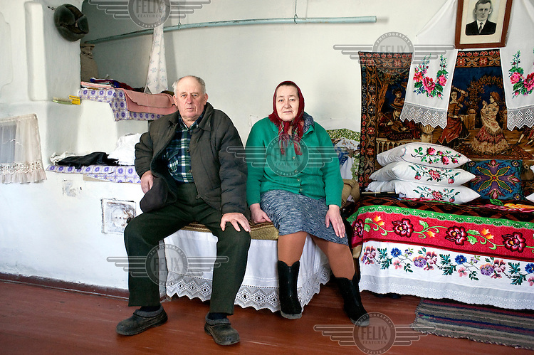Vasil Pavlovic and his wife Olga Ivanovna at their home in the village of Opachichi located within the Chernobyl 30 km exclusion zone. On 26 April 1986 a nuclear accident at the nearby Chernobyl power plant led to the evacuation of all people living with 30 km of the plant. However, Vasil and Olga were among a few hundred former residents who, despite the risk of radiation exposure, chose to return to their former homes.