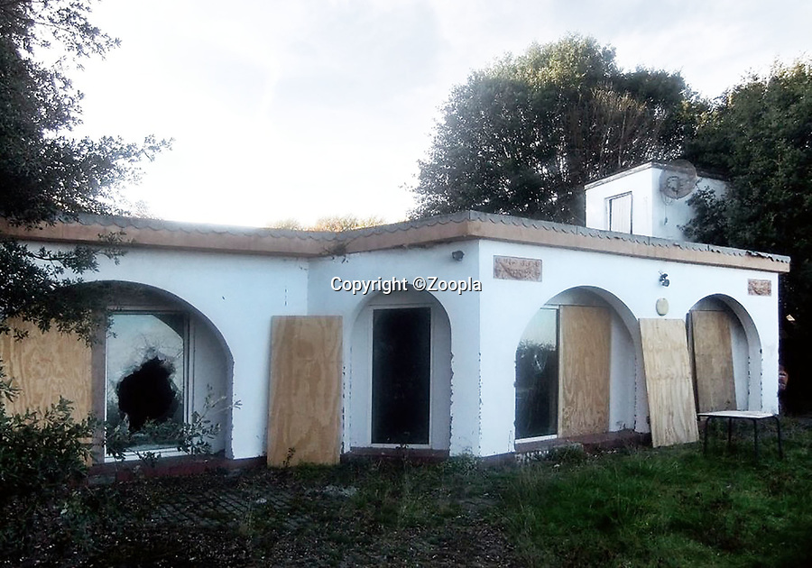 BNPS.co.uk (01202 558833)<br /> Pic: Zoopla/BNPS<br /> <br /> Before work began in 2015...<br /> <br /> A former WW2 battery, with unrivalled views across the channel to France, has come on the market - but you'll need deep pockets to shell out on its stunning location.<br /> <br /> The cliff top gun emplacement was rapidly constructed in 1940, as Britsh troops were fleeing Dunkirk, and has now been transformed into a £6million 'James Bond style' property.<br /> <br /> The Gunnery, near Kingsdown in Kent offers 'incredible' views of the Channel, with the iconic White Cliffs of Dover visible to the west, and France to the south, while also coming with six acres of sandy beach.<br /> <br /> The unique 82ft long property is accessed by an underground tunnel that leads through the cliff to a glass lift which travels up to it. Another secret tunnel inside the four bedroom home, which is just a few feet from the cliff edge, provides passage to a home cinema.<br /> <br /> The 50ft long living room has floor to ceiling windows and the original gun loops can still be seen.