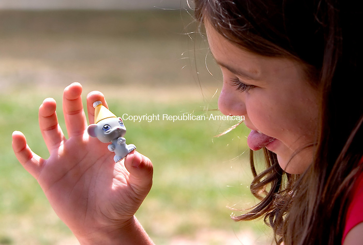 WOODBURY, CT- 02 JULY 2007- 070207JT04-<br /> Sydney Racevicius, 7, of Woodbury, makes a face at one of her Littlest Pet Shop toys as she plays with  her sister Taylor, 11, and friend Melissa Real, 7, at Hollow Park in Woodbury on Monday.<br /> Josalee Thrift Republican-American