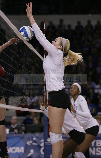 Sophomore Lauren O'Conner (12) blocks the ball during the University of Kentucky vs Ohio State University in the second round of the NCAA Volleyball Tournament in Lexington, Ky., on, 12/1/2012. Photo by Jared Glover | Staff