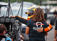 Aug 19, 2018; Brainerd, MN, USA; NHRA top fuel driver Mike Salinas with crew member during the Lucas Oil Nationals at Brainerd International Raceway. Mandatory Credit: Mark J. Rebilas-USA TODAY Sports