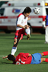 11 February 2006: Korea's Jae-Jin Cho (9) leaps over Costa Rica's Michael Rodriguez (21) to head the ball. The Costa Rica Men's National Team defeated South Korea 1-0 at McAfee Coliseum in Oakland, California in an International Friendly soccer match.