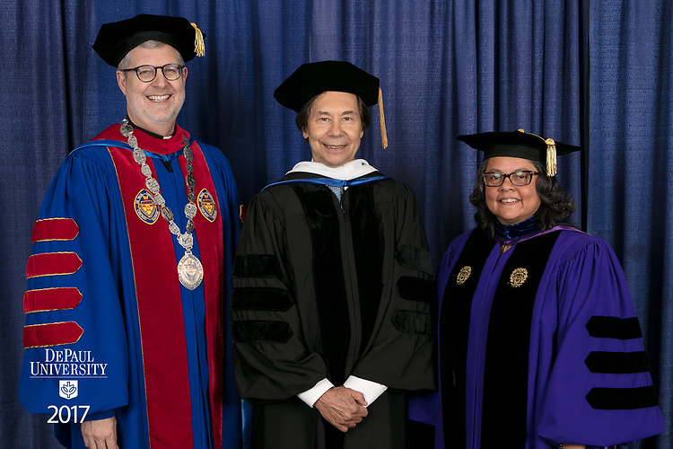 Left to right, the Rev. Dennis H. Holtschneider, C.M., president of DePaul, commencement speaker and honorary degree recipient Stuart Dybek, poet and fiction writer, Marisa Alicea, dean of the School for New Learning. DePaul University School for New Learning held its commencement ceremony, Saturday, June 10, 2017, at the Rosemont Theatre in Rosemont, IL. The Rev. Dennis H. Holtschneider, C.M., president of DePaul, conferred the degrees. (DePaul University/Jeff Carrion)