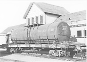 Side-end view of water car #06217 (Tank type) at Durango.  Car marked with journals repacked date of 5/3/1965.<br /> D&amp;RGW  Durango, CO  after 5/3/1965