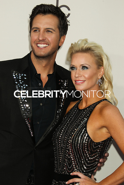 LOS ANGELES, CA - NOVEMBER 24: Luke Bryan, Caroline Bryan arriving at the 2013 American Music Awards held at Nokia Theatre L.A. Live on November 24, 2013 in Los Angeles, California. (Photo by Celebrity Monitor)