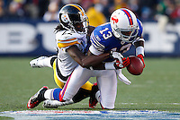 ORCHARD PARK, NY - NOVEMBER 28:  William Gay #22 of the Pittsburgh Steelers defends a pass in front of Steve Johnson #13 of the Buffalo Bills during the game on November 28, 2010 at Ralph Wilson Stadium in Orchard Park, New York.  (Photo by Jared Wickerham/Getty Images)