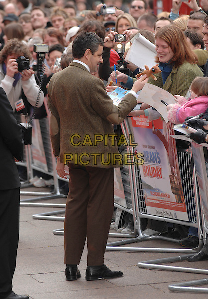 "ROWAN ATKINSON AS MR. BEAN.Arrives to the UK Film Premiere of ""Mr. Bean's Holiday"" at Odeon Leicester Square, London, England, .March 26th 2007..full length funny face fans teddy bear back behind.CAP/PL.©Phil Loftus/Capital Pictures"