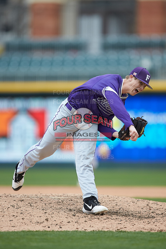 Furman Paladins relief pitcher Joshua Germany (18) follows through on his delivery against the Wake Forest Demon Deacons at BB&T BallPark on March 2, 2019 in Charlotte, North Carolina. The Demon Deacons defeated the Paladins 13-7. (Brian Westerholt/Four Seam Images)