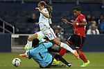 15 October 2014: Kimika Forbes (TRI) (1) knocks the ball away from Alex Morgan (USA) (13) as Lauren Hutchinson (TRI) (20) trails the play. The United States Women's National Team played the Trinidad and Tobago Women's National Team at Sporting Park in Kansas City, Kansas in a 2014 CONCACAF Women's Championship Group A game, which serves as a qualifying tournament for the 2015 FIFA Women's World Cup in Canada. The United States won the game 1-0.