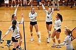 Althoff players celebrate after scoring late in the second game. Althoff defeated Columbia in two games in volleyball action on Thursday August 23, 2018.<br /> Tim Vizer/Special to STLhighschoolsports.com