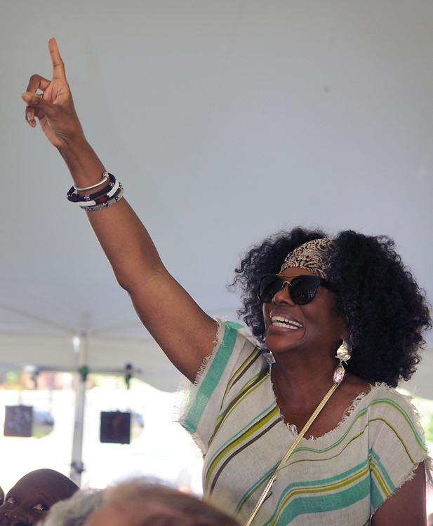 Event organizer, Greer Smith, responding to being acknowledged by performer Kenyatta Beasley, at the 2014 Jazz in the Valley Festival held in Waryas Park on the Hudson River front in Poughkeepsie, NY on Sunday August 17, 2014. Photo by Jim Peppler. Copyright Jim Peppler 2014 all rights reserved.