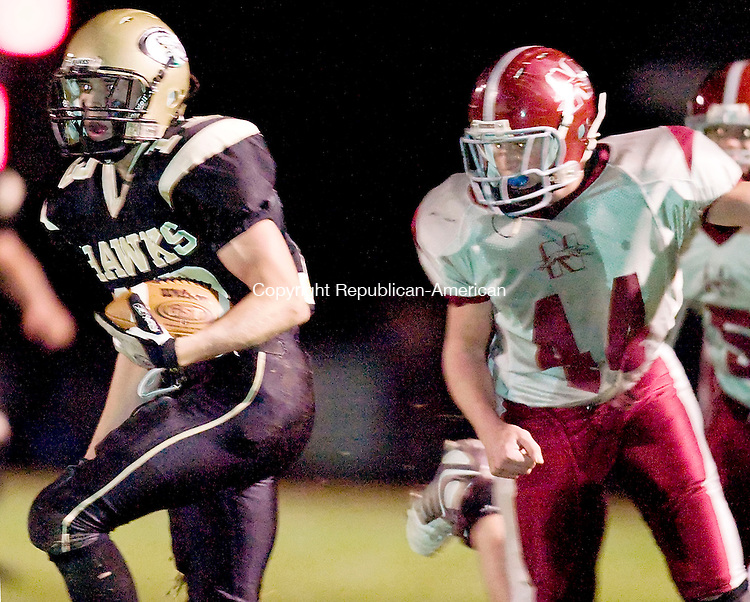 BEACON FALLS, CT--02 November 07--110207TJ03 - Will Volage (13), of Woodland, looks for a line after completing a pass as Naugatuck's Ryan Piccirillo (44) closes in for a tackle during a game at Woodland Regional High School in Beacon Falls on Friday, November 2, 2007. T.J. Kirkpatrick/Republican-American