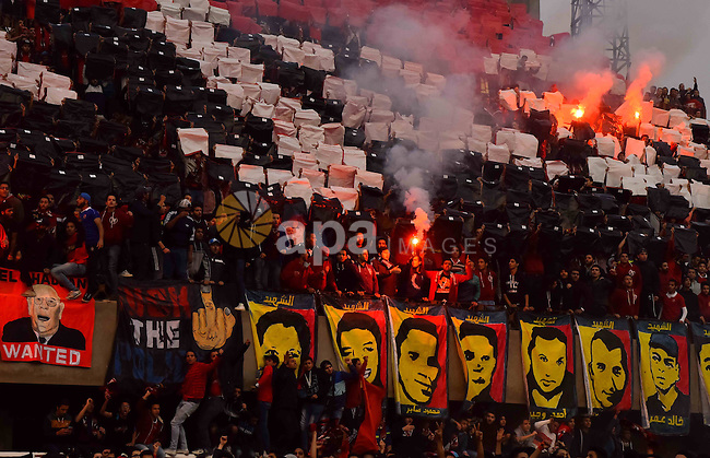 """Al Ahly fans, also known as """"Ultras"""", light flares and shout slogans at al-Ahly club's training stadium marking the fourt anniversary of killing al-Ahly fans in what known as the """"Port Said massacre"""", on February 1, 2016. On 1 February 2012, a massive riot occurred at Port Said Stadium in Port Said city, Egypt, following an Egyptian Premier League football match between El Masry and El Ahly clubs. At least 74 people were killed and more than 500 were injured after thousands of El Masry spectators stormed the stadium stands and the pitch. Photo by Amr Sayed"""