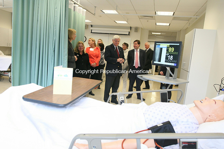 WINSTED, CT - 5 November, 2010 - 110510MO04 - Rep. John B. Larson, D-1st District, inspects one of the high-tech mannequins purchased with a federal grant that will allow nursing students to take a pulse, and other vital signs, and even simulates patient responses to treatment. Larson was among several dignitaries who attended the grand opening Friday of the school's new nursing lab.  Jim Moore Republican-American.