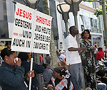 10 June 2006: Soccer fans and locals enjoy market day in Frankfurt before the game. Christian missionaries make their pitch to the crowd. England played Paraguay at Commerzbank Arena in Frankfurt, Germany in match 3, a Group B first round game, of the 2006 FIFA World Cup.