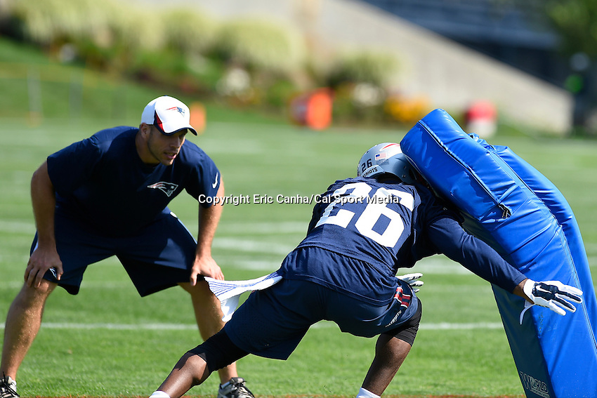 July 25, 2014 - Foxborough, Massachusetts, U.S.- New England Patriots cornerback Logan Ryan (26) works under the watch of assistant defensive coach Brendan Daly during the New England Patriots training camp held at Gillette Stadium in Foxborough Massachusetts.  Eric Canha/CSM