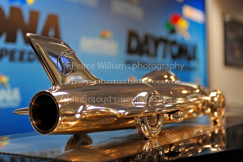 The Harley J. Earl Daytona 500 Trophy (looks like the Delta Wing Indy Car)