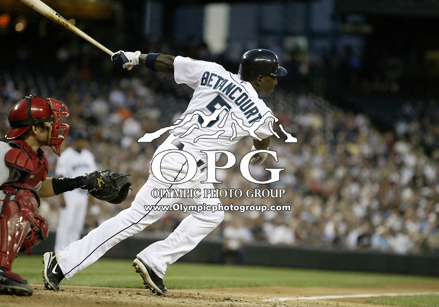 01 August 2007:   Seattle Mariners Yuniesky Betancourt connects for a base hit against the Los Angeles Angels at Safeco Field . Seattle won 8-7 in 12 innings.