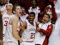 Indiana University guard Remy Abell (23) and teammates react to basket during their men's NCAA basketball game against Virginia Commonwealth University in Portland, Oregon,  March 17, 2012.  REUTERS/Steve Dipaola (UNITED STATES)