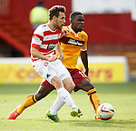 Tony Andreu slots away the opening goal for Hamilton Accies as he beats the challenge of the despairing Zane Francis-Angol of Motherwell