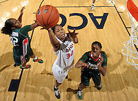 Jan. 6, 2011; Charlottesville, VA, USA; Virginia Cavaliers forward Telia McCall (30) shoots between Miami Hurricanes guard Shenise Johnson (42) and Miami Hurricanes guard Krystal Saunders (12) during the game at the John Paul Jones Arena. Miami won 82-73. Mandatory Credit: Andrew Shurtleff-