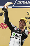 KUALA LUMPUR, MALAYSIA - OCTOBER 25:  Scot Racing Team rider Hiroshimi Aoyama celebrates on the podium after winning the 250cc race during the Malaysian MotoGP, which is round 16 of the MotoGP World Championship at the Sepang Circuit on October 25, 2009 in Kuala Lumpur, Malaysia. Photo by Victor Fraile / The Power of Sport Images