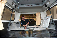 BNPS.co.uk (01202 558833)<br /> Pic: LauraJones/BNPS<br /> <br /> Accessory fitter Simon Prichard doing a pre delivery inspection.<br /> <br /> The last ever delivery of brand new Volkswagen campervans has arrived in Britain marking the end of an era for the iconic 'hippy bus'.<br /> <br /> Ninety nine of the final batch of vans rolled off the production line and onto a container ship bound for British shores after manufacture ceased for good in Brazil in December.<br /> <br /> And though the consignment has only just arrived, almost all of the vans have already been snapped up by eager buyers happy to fork out the &pound;35,000 starting price.<br /> <br /> They are the last brand new campers in all of Europe.