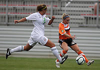 BOYDS, MARYLAND - July 21, 2012:  Macky Wingo (17) of Charlotte Lady Eagles crosses the ball past Elyse Tomasello (13) of the Long Island Roughriders during a W League Eastern Conference Championship semi final match at Maryland Soccerplex, in Boyds, Maryland on July 21.