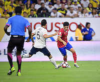 Christian Bolanos of Costa Rica attempts to dribble the ball around Guillermo Celis of Colombia on Saturday, June 11, 2016 at NRG Stadium in Houston Texas.