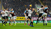 Burnley's Ben Mee attacks a corner under pressure from Fulham's Cyrus Christie<br /> <br /> Photographer Alex Dodd/CameraSport<br /> <br /> The Premier League - Burnley v Fulham - Saturday 12th January 2019 - Turf Moor - Burnley<br /> <br /> World Copyright © 2019 CameraSport. All rights reserved. 43 Linden Ave. Countesthorpe. Leicester. England. LE8 5PG - Tel: +44 (0) 116 277 4147 - admin@camerasport.com - www.camerasport.com